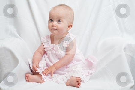 Pink Dress stock photo, Cute little caucasian baby girl wearing pink dress on a white background by Mariusz Jurgielewicz
