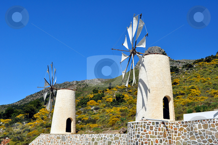 Wind mills in Crete stock photo, Travel photography: traditional wind mills in the Lassithi plateau, Crete. by Fernando Barozza