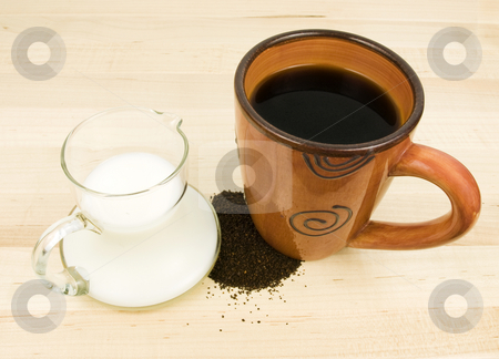 Coffee with Creamer stock photo, Coffee with creamer and grounds on wooden background by John Teeter