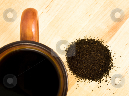 Coffee grounds with mug stock photo, Coffee grounds with mug on a wooden background by John Teeter