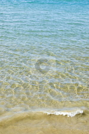 Breaking Wave stock photo, Small waves lapping onto a sandy beach by Stephen Gibson