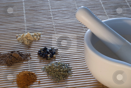 Spice Grinder stock photo, A pestle and mortar with a selection of ground spices, coriander, chilli, pepper, and cumin by Stephen Gibson