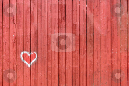 Red wood boards with heart painting stock photo, Red wall with a heart painted on it by Anders Peter