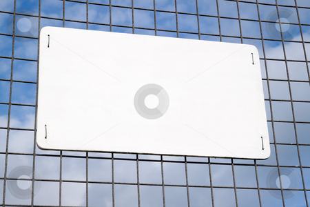 Blank white sign on a metal security fence. stock photo, Blank white sign on a metal security fence. by Stephen Rees