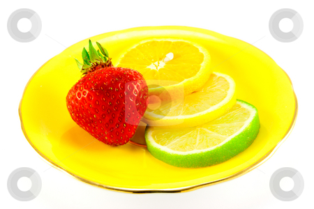 Citrus Fruit and Strawberry stock photo, Slice of lemon, lime and orange with a red juicy strawberry on a fancy yellow plate with a white background by Keith Wilson