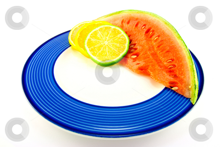 Watermelon with Citrus Slices stock photo, Slice of red juicy watermelon with lemon, lime and orange slices on a blue plate with a white background by Keith Wilson