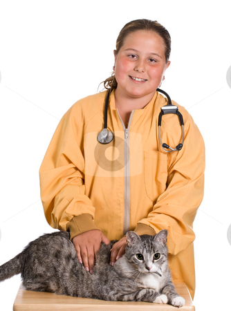 Animal Care stock photo, A young girl looking after her pet cat as he sits on a small table by Richard Nelson