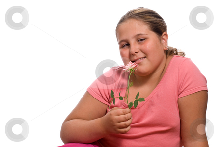 Girl Smelling A Rose stock photo, A young girl smelling a fresh rose isolated against a white background by Richard Nelson