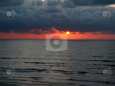 Brooding cloudy sunset stock photo, Horizontal landscape of moody Pacific coast sunset and gentle surf by Jill Reid