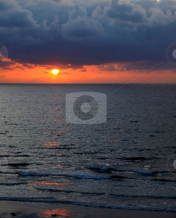 Pacific stormy sunset stock photo, Vertical image of moody Pacific coast sunset and gentle surf by Jill Reid