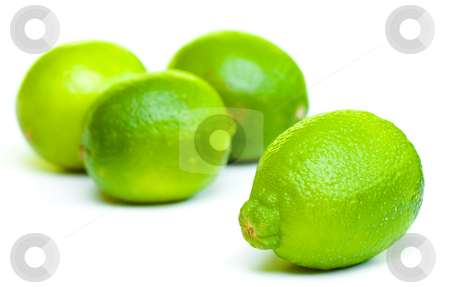 Isolated fruits - limes stock photo, Limes on white background. Front lime is sharp detail and three limes at the background are out of focus by Hieng Ling Tie