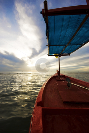 Red Fishing Boat stock photo, A red wooden fishing boat on the ocean at sunrise by Stefan Breton