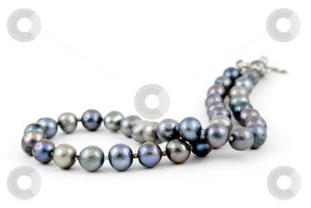 Andaman Sea Pearl Necklace stock photo, A beautiful necklace made of pearls of the Andaman sea of the coast of Thailand, on a white background. Adobe RGB color profile. by Stefan Breton