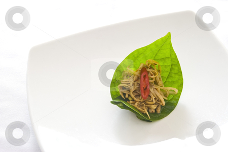 Spicy Bamboo Salad On A Leaf stock photo, Spicy bamboo salad topped with a sliced red pepper, presented on a betel leaf and served on a white ceramic plate. Traditional Thai cuisine. by Stefan Breton