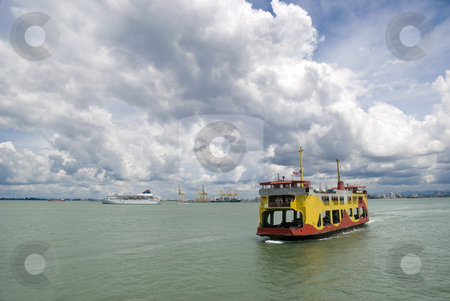 The Penang Ferry Boat stock photo, The Penang (Malaysia) ferry boat doing a crossing between Georgetown and Butterworth on a dramatically cloudy day. by Stefan Breton