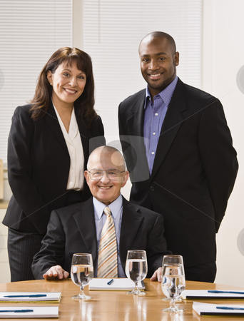 Business People in Office stock photo, A group of business people are in an office and are smiling at the camera.  Vertically framed shot. by Jonathan Ross