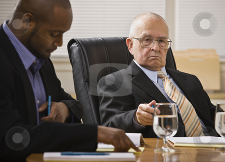 Two business men meeting stock photo, Two business men meeting,one African American, one white senior male. Horizontal. by Jonathan Ross