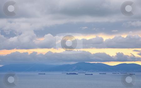 Ships, facing the harbor stock photo, Ships, facing the harbor, on the horizon, in the evening by Valery Kraynov