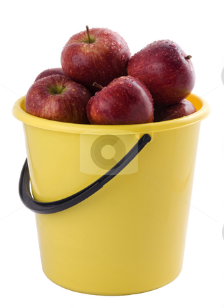 red apples in a yellow bucket stock photo, red apples in a yellow bucket, isolated on white background. by Valery Kraynov