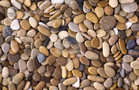 Stone background stock photo, Abstract background with a lot of round peeble stones by Valery Kraynov