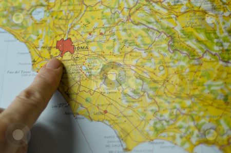 Pointing Rome on the map stock photo, Hand showing the position of Rome on a map of Italy by Alessandro Rizzolli