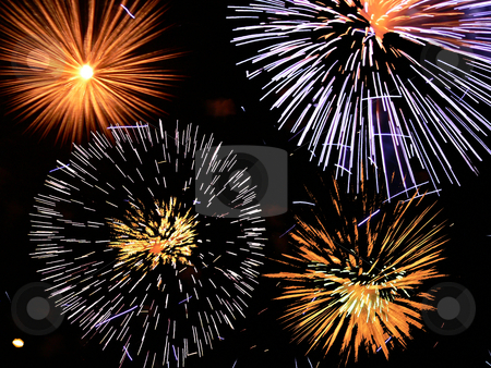 Fireworks stock photo, Various fireworks going off together, photographed by a slow shutter speed by Casinozack