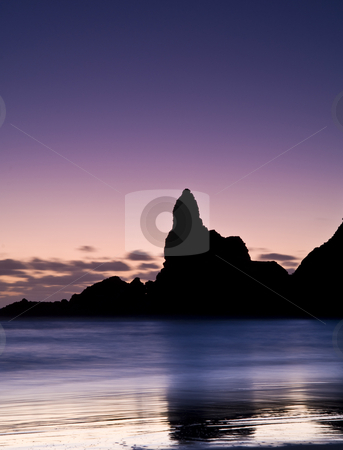 Glowing Sands stock photo, Long exposure of Lion Rock, Piha, a famous New Zealand surf beach by Robin Ducker