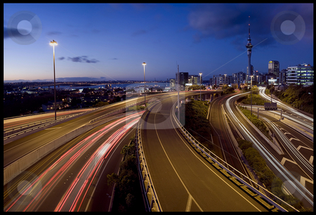 Every day stock photo, A long exposure evening Panorama of Auckland City and the motorway/ expressway aimed at producing a glowing cityscape while also portraying the monotony of commuting by Robin Ducker