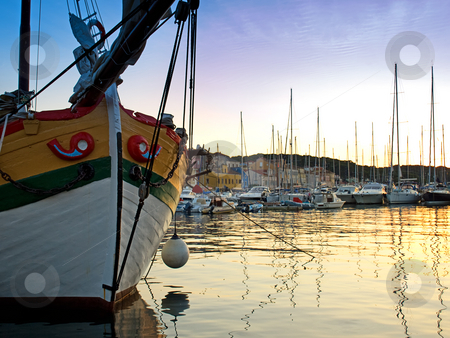 Harbor of Losinj stock photo, View of the quiet port of Losinj in the summer twilight. by Sinisa Botas