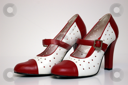 High Heel stock photo, A side view of a pair of red and white high heels on white. by Tom Weatherhead
