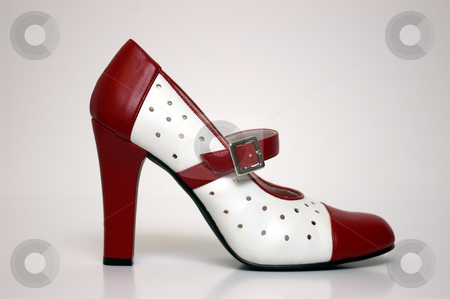 High Heel stock photo, A side view of a red and white high heel on white. by Tom Weatherhead