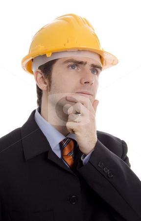 Man  stock photo, Man thinking with yellow helmet white isoalte by Marc Torrell