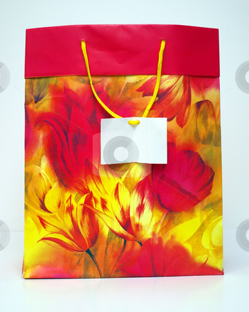 Gift bag stock photo, A large gift bag for Christmas or birthday gifts with a blank card on the handle. by Tom Weatherhead