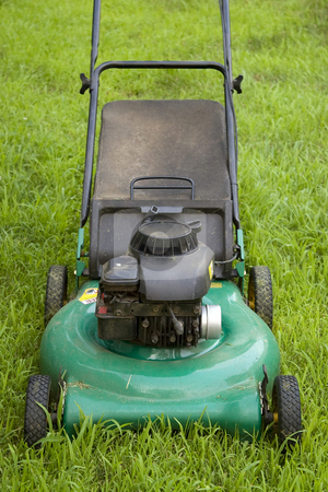 Green Lawn Mower stock photo, A green push style lawn mower ready for some weekend action. by Todd Arena