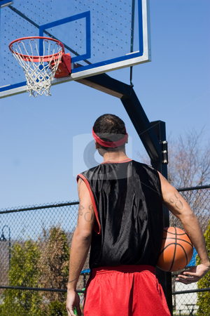 Basketball Player stock photo, A young man holding a basketball on the court. by Todd Arena