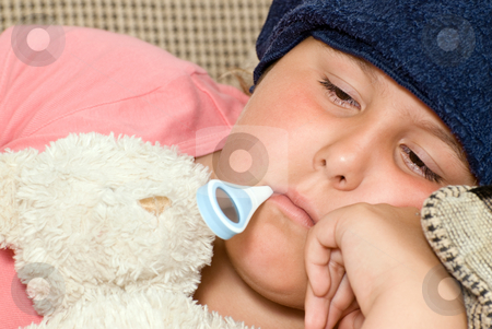 H1N1 stock photo, A young girl is sick with H1N1 and has a thermometer in her mouth by Richard Nelson
