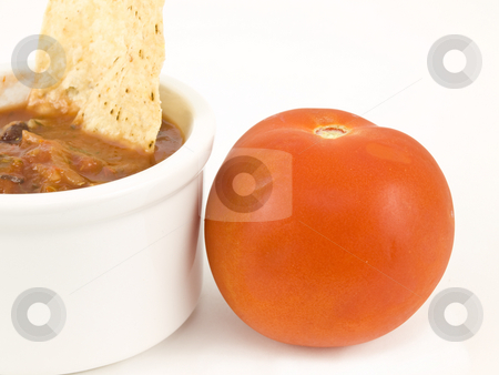 Chips and salsa with tomato stock photo, Chips and salsa with tomato on white background by John Teeter