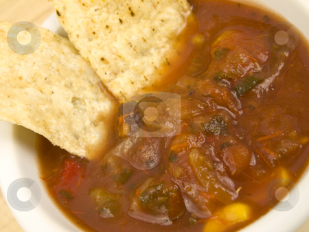 Chips and Salsa stock photo, Chips in salsa with a close up view by John Teeter