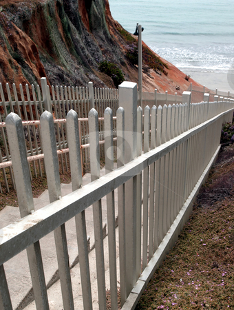 Staircase and railing to the beach stock photo, A concrete staircase and railing lead to the beach by Jill Reid