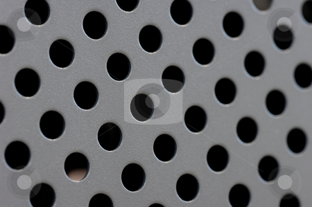 Round Steel Holes stock photo, Round steel holes for backgrounds or textures. by Peter Soderstrom