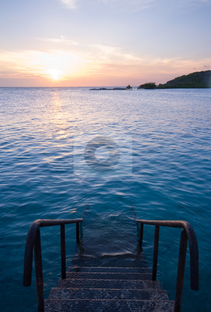 Sea swimming pool stock photo, Natural sea swimming pool with staircase and sunset by Karin Claus