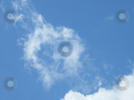 Hollow Heart Cloud  stock photo, Hollow Heart Shape Cloud in a Spring Blue Sky. by Dazz Lee Photography