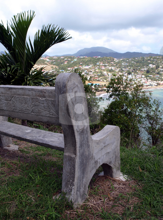Concrete bench overlooking St. Lucia bay stock photo, An empty concrete bench overlooking a bay in St. Lucia by Jill Reid