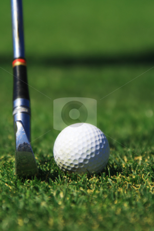 Hitting a golf ball stock photo, An Iron club preparing to hit a golf ball by Damien Richard