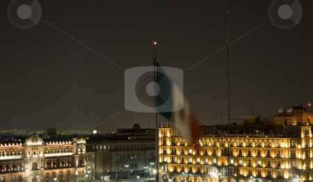 President's Palace Mexico Zocalo with Flag at Night stock photo, The Zocalo, Center of Mexico City, with President's Palace in Background with Mexican Flag by William Perry