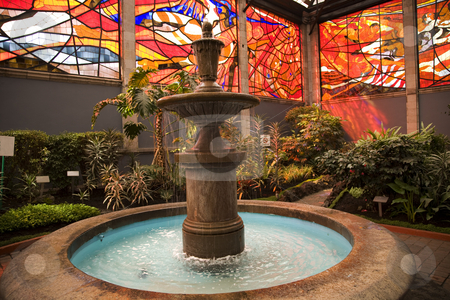 Cosmovitral Garden with Fountain Toluca Mexico stock photo, Cosmovitral is a very famous botanical garden in Toluca, Mexico, which is surrounged with stained glass.  This is one of the fountains. by William Perry