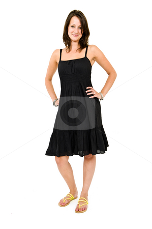 Young woman stock photo, Young brunette standing with her hands on heer hips looking defiantly by Corepics VOF