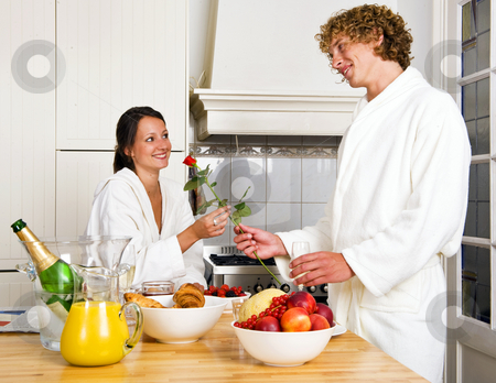 Lovers breakfast stock photo, Young couple enjoying a luxurious champagne breakfast on a sunday morning by Corepics VOF
