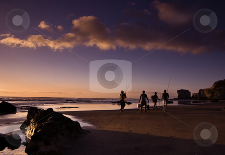 Homeward bound stock photo, Maori Bay Near Auckland: 4 fisherman with the days rewards homeward bound at the end of a day of surf casting by Robin Ducker