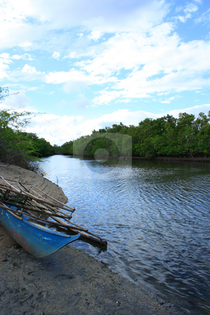 Tropical forest river stock photo, Tropical forest river with an abandoned old wooden boat located in a remote forest in the Philippines by Claro Alindogan